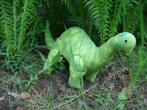 Green Dino among the ferns